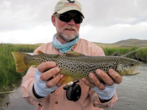 Capt. Rick Grassett with brown trout caught and released on a fly while fishing out of Crane Meadow Lodge in Twin Bridges, MT.