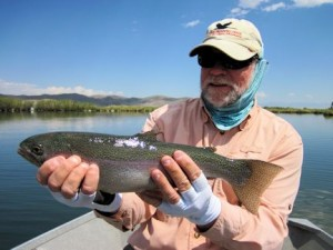 Capt. Rick Grassett with rainbow trout caught and released on a fly while fishing out of Crane Meadow Lodge in Twin Bridges, MT.