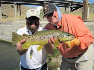 Lynn Skipper, from Apollo Beach, FL with a  brown trout caught and released on a fly while fishing out of Crane Meadow Lodge in Twin Bridges, MT.