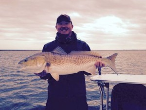 Jon Yenari, from Sarasota, FL with a red caught and released on a jig under a popping cork while fishing out of Hopedale, LA.