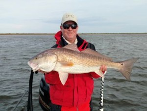 Kirk Grassett, from Middletown, DE with a  red caught and released on a fly while fishing out of Hopedale, LA.