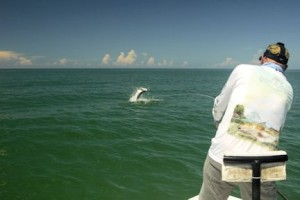 Steve Gibson, from Sarasota, battles a tarpon caught and released on a fly while fishing with Capt. Rick Grassett.