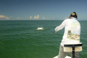 Steve Gibson, from Sarasota, bows to a tarpon jump while fly fishing with Capt. Rick Grassett.