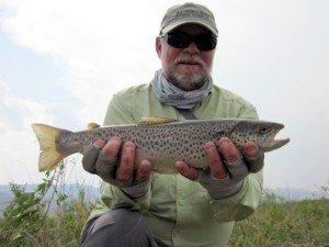 Capt. Rick Grassett with a Montana brown trout caught and released while stripping streamers with guide Dave King, of King Outfitters in Dillon, MT.