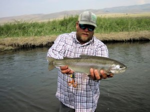 Guide Dave King, of King Outfitters in Dillon, MT, with a big Montana rainbow caught and released by Mike Perez, from IN, on a streamer.