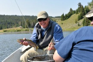Tim Siegel, from IN, with a cutthroat caught and released on a dry fly while fishing an alpine lake at 7500' with guide Cody Meine on his Smallhorn Mountain Ranch.