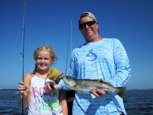 Randy Ritzenhaler, from TX, and his daughter, Elise,  had some action catching and releasing trout on a CAL jig with a shad tail and an Ultra Hair Clouser fly while fishing Sarasota Bay with Capt. Rick Grassett.