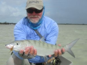 Capt Rick Grassett with a South Andros bonefish caught and released on a fly while fishing out of Mars Bay Bonefish Lodge.