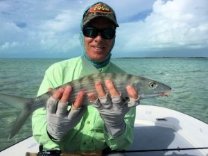 Stewart Lavelle, from Sarasota, FL, with a South Andros bonefish caught and released on a fly while fishing out of Mars Bay Bonefish Lodge.