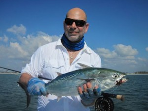 Massimo Giardina , from Switzerland, caught and released his first false albacore on a fly while fishing the coastal gulf in Sarasota with Capt. Rick Grassett.
