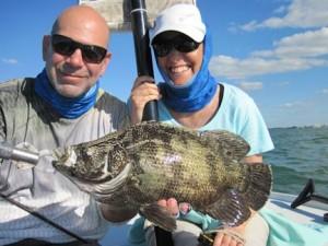 "Massimo Giardina and Tatiana Migliaretti, from Switzerland, caught this nice tripletail in the coastal gulf on a 2.75"" DOA Shrimp while fishing with Capt. Rick Grassett."