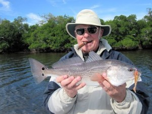 You should find reds in backcountry areas in January. Keith McClintock, from Lake Forest, IL, caught this one on a CAL jig with a shad tail while fishing near Boca Grande with Capt. Rick Grassett in a previous January.