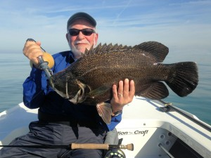 Martin Marlowe, from NY, with a big tripletail caught and released on a shrimp fly pattern on a 7-wt fly rod while fishing the coastal gulf with Capt. Rick Grassett.