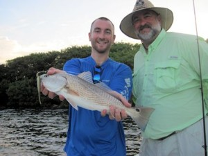 Scottie Heidler, from Miami and Scott Heidler, from, OH, with a red that Scottie caught and released on a CAL jig with a jerk worm while fishing Sarasota Bay with Capt. Rick Grassett.