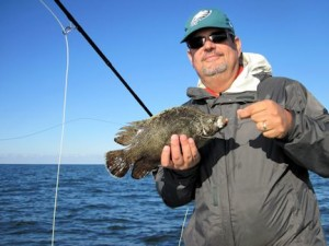 Nick Delle Donne, from PA,, with a tripletail caught and released on a Grassett Flats Bunny fly while fishing in Sarasota with Capt. Rick Grassett.