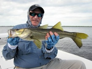 Jerry Roth, from Sanford, FL, with a snook caught and released on a top water plug while fishing Tampa Bay with Capt. Rick Grassett.