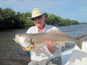 "Keith McClintock, from Lake Forest, IL, with a 28"" red caught and released on a CAL jig with a shad tail while fishing Gasparilla Sound near Boca Grande with Capt. Rick Grassett."