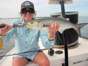Mireya Castillo, from Salt Lake City, UT, with a nice bluefish caught on a fly while fishing with Capt. Rick Grassett in a previous December.