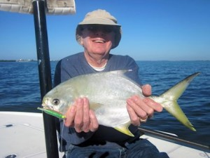 Walter Poxon, from MN, with a nice pompano caught on a CAL jig with a shad tail while fishing Sarasota Bay with Capt. Rick Grassett in a previous December.