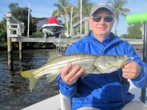 Rick Anderson, from IL, with a snook caught and released on a CAL jig with a shad tail while fishing Little Sarasota Bay with Capt. Rick Grassett.