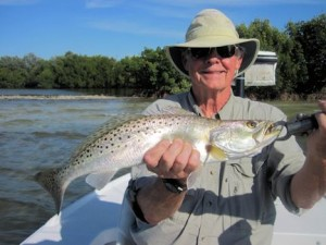 Keith McClintock , from Lake Forest, IL, with a nice trout  caught and released on a CAL jig with a shad tail while fishing Gasparilla Sound near Boca Grande in a previous February with Capt. Rick Grassett.