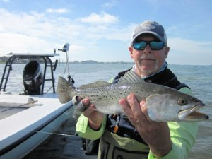 Mike Perez, from Sarasota, waded a Sarasota Bay sand bar with Capt. Rick Grassett and caught and released this big trout on a fly in a previous February.