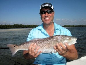 Stephen Liska, from Naples, FL, with a red  caught and released on a CAL jig with a shad tail while fishing Gasparilla Sound near Boca Grande in a previous February with Capt. Rick Grassett.