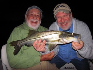 Martin Marlowe, from NY, and his son Bruce Marlowe, from SC, with a snook caught and released on a Grassett Snook Minnow fly while fishing the ICW at night with Capt. Rick Grassett.