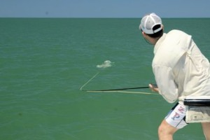 Sean Sherman, from NYC, battles a tarpon while fly fishing the coastal gulf with Capt. Rick Grassett in a previous May.