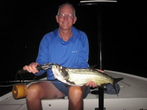 Bob Delano, from GA, with a tarpon caught and released on a fly on a pre dawn trip with Capt. Rick Grassett in a previous August.