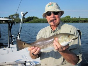 Keith McClintock, from IL, with a red  caught and released in Sarasota Bay on a CAL jig with a shad tail while fishing with Capt. Rick Grassett in a previous November.
