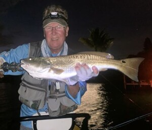 Mangrove Coast Fly Fishers (MCFF) president Ken Babineau, from Sarasota, with a red and trout caught and released on a fly while fishing Sarasota Bay with Capt. Rick Grassett recently.