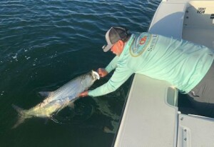 Capt.Rick Grassett releases a tarpon caught and released in Sarasota on a DOA TerrorEyz.