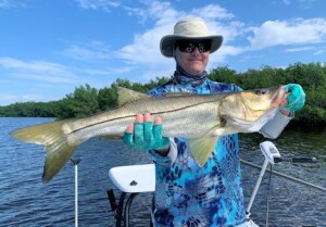 Kyle Ruffing, from Sarasota, with a big snook caught and released on a CAL Shad while fishing Gasparilla Sound with Capt. Rick Grassett recently.